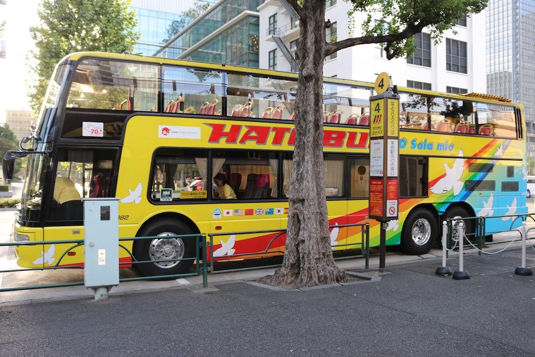 """""""'O Sola mio"""" is an open-top double decker bus."""