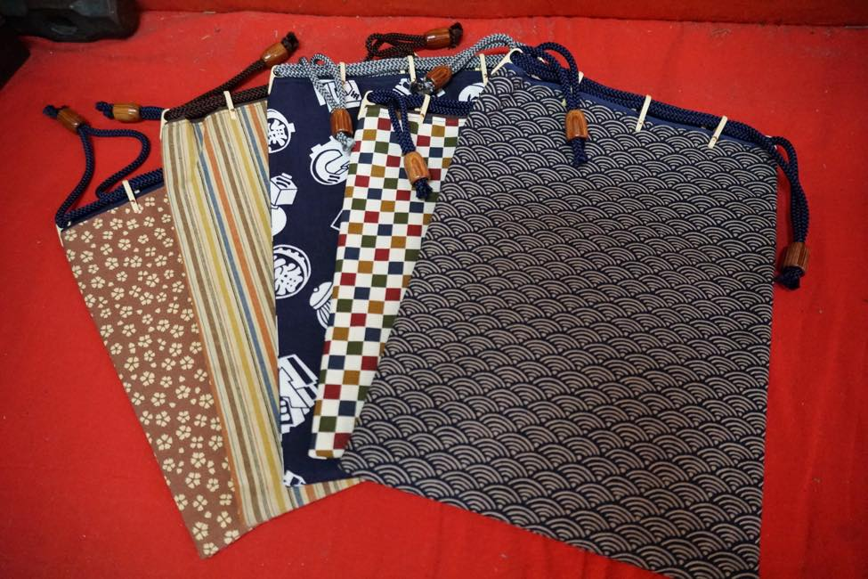Drawstring bags using traditional patterns are also popular